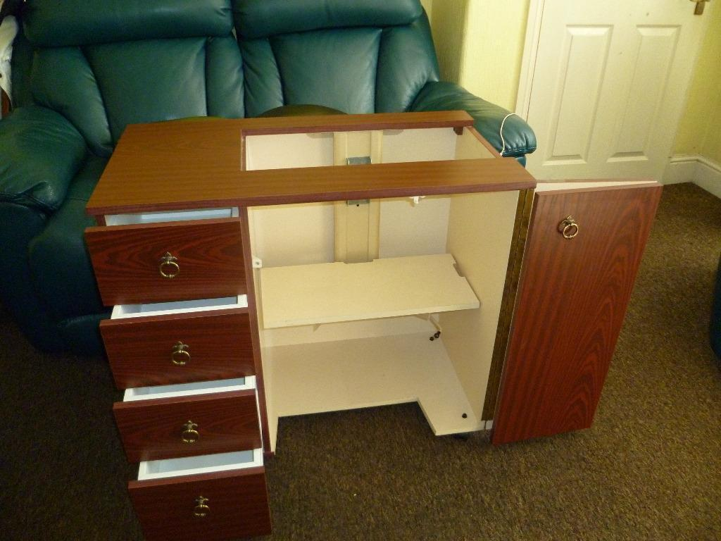 sewing machine cabinets with air lift