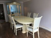 Dining room table and chairs with a matching ornamental display and storage unit. In good condition.