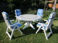 Nardi patio table, Four reclinging chairs & cushions