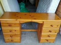 Pine desk with drawers.