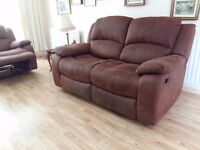 Two x 2 seater brown leather (suede) recliner suite. Very clean. No rips or tears.