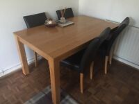 Solid Oak Dining Table with 4 leather chairs. In excellent condition, collection only.