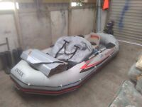 selling good rubber boat with motor.