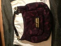 Coach shoulder bag with cross body strap.