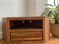 Wooden corner TV stand.