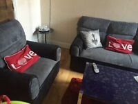 USED GOOD CONDITION Grey and Black sofas 3+2+1 Seaters