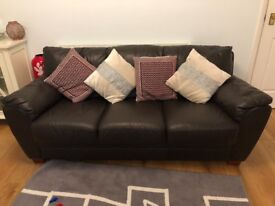 3 greater dark brown leather sofa in good condition - £40