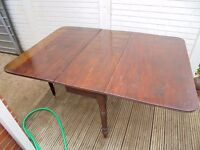 Victorian drop leaf mahogany dining table with swing out legs to support leaves