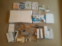 Wii bundle including fit board and games