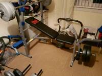 Weights bench with leg curl and weights