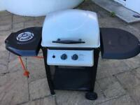 Unused gas barbecue with side burner