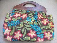 Brown flower pattern handbag with wooden handles