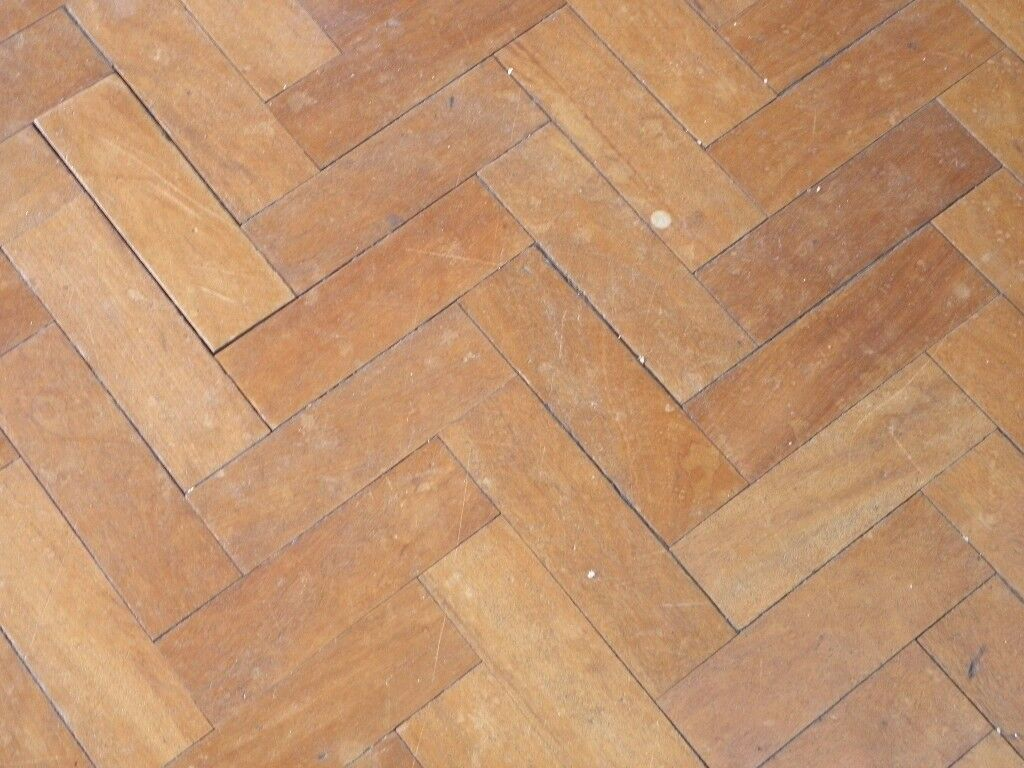 solid wood block flooring, each piece 9 inch by 3 inch, 21mm thick, all have pitch still on them