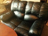Black leather reclining sofas , used but good condition, buyer must collect