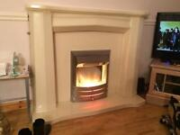Electric fire with a marble effect surround