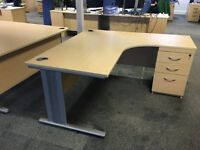 Single ergonomic corner desk with fixed pedestal. Beech finish.
