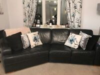 Black leather angled sofa
