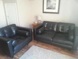 Italian leather sofa and snuggle chair