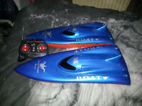 Two radio controlled speed boats