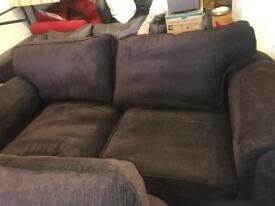 Suede brown sofa with hints of navy