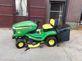 Ride on John Deere lawn mower