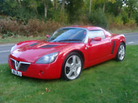 VX220. Low milage. Hard top and soft top included. THE Ecconomical and Affordable Red Sports Car