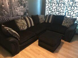 Black corner sofa and footstool