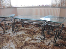 REDUCED! Glass top set of 3 coffee tables with ornate gun metal legs
