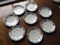 8 Poole pottery saucers in very good condition. 'Cranborne' design. Sorry, no cups