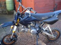 pit bike 125 cc many new parts fitted . Helmet size M and body armour