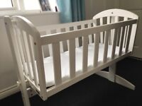 White rocking crib used only few times as baby would not settle in it