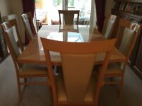 High Gloss, light coloured centre pedestal dining table, 8 chairs, sideboard and coffee table