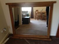 Large mirror with wood frame.