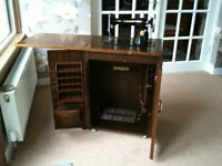 Singer Treadle Sewing Machine, in full working order, fitted within a Mahogany 2 door cabinet..