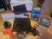 Playstation 3 boxed with games and extras