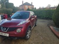 Red Nissan juke for sale.