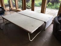 Single bed base with truckle base below to convert to double