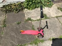 Micro Scooter with extra 'toddler handle' with removable seat. Pink. Great condition.