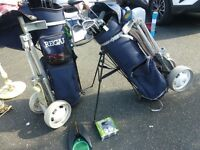2 SETS OF GOLF CLUBS PLUS TROLLY