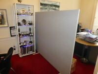Office Partition Screen. Free standing, screen. Light grey fabric covering.