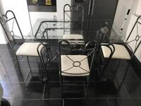 Glass top dining table with 4x chairs