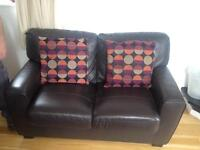 Brown faux leather sofas