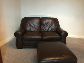 Leather couch and foot rest for sale! Needs gone.
