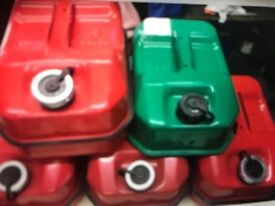 4 x 10lt red petrol cans and 1 5lt green petrol can