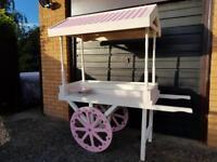 Handmade sweet cart with sweet jars