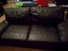 Free to collect black faux leather sofa