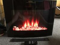 Electric fire with flame and pebble effect