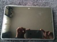 Kindle bran new never used with standing cover also Nintendo dsi 4 games