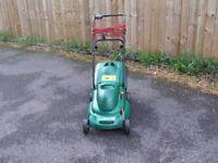 qualcast 400 lawnmower with grass box metal blade .