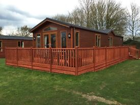 Woodland lodge for sale at Yaxham Waters Holiday Park Norfolk very quiet and relaxing great fishing!